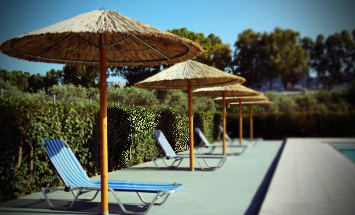 Tina Flora Hotel Umbrellas at Pool
